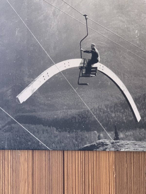 construction worker riding the Mt. Norquary Chairlift