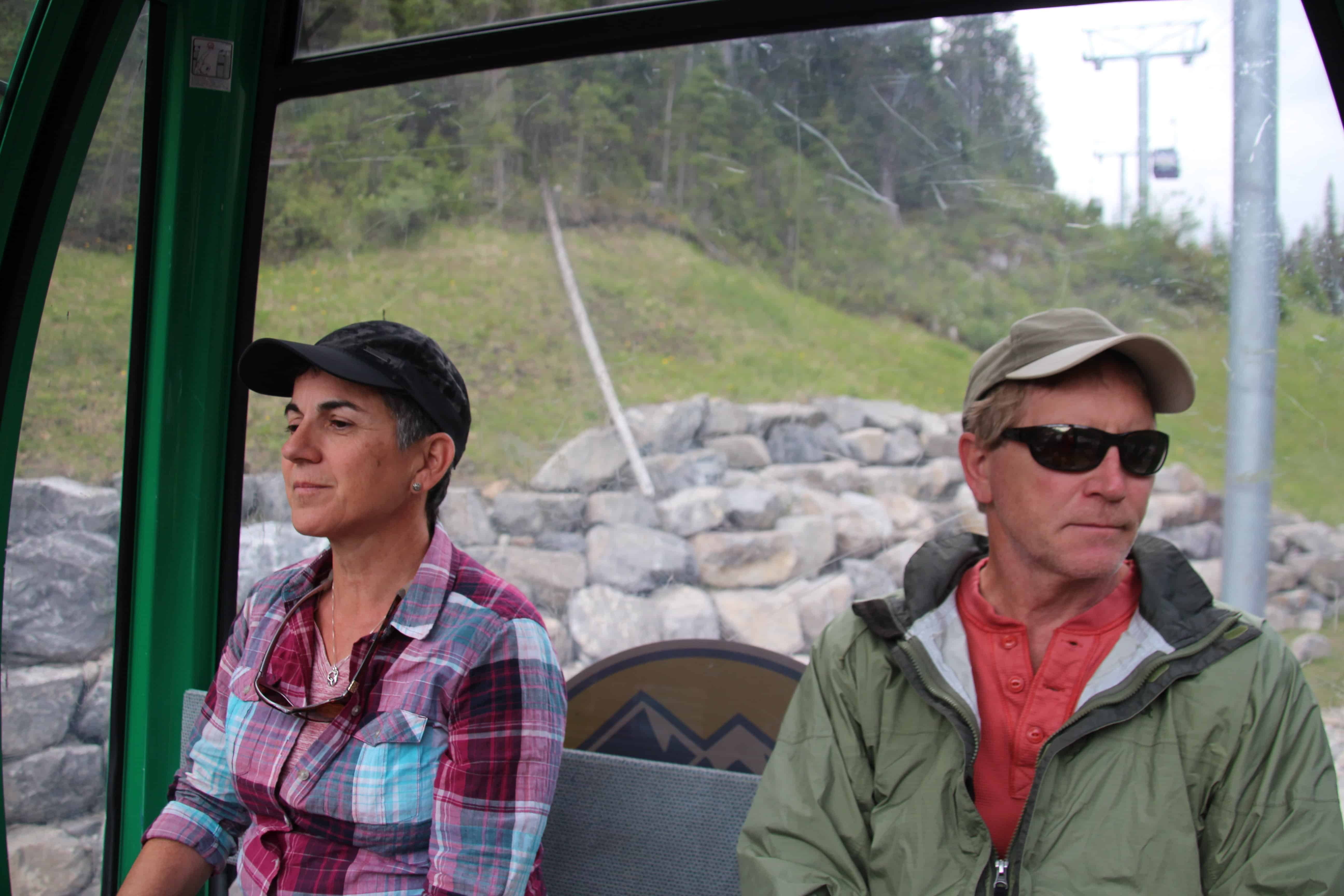 two people sitting on the sunshine gondola, banff national park