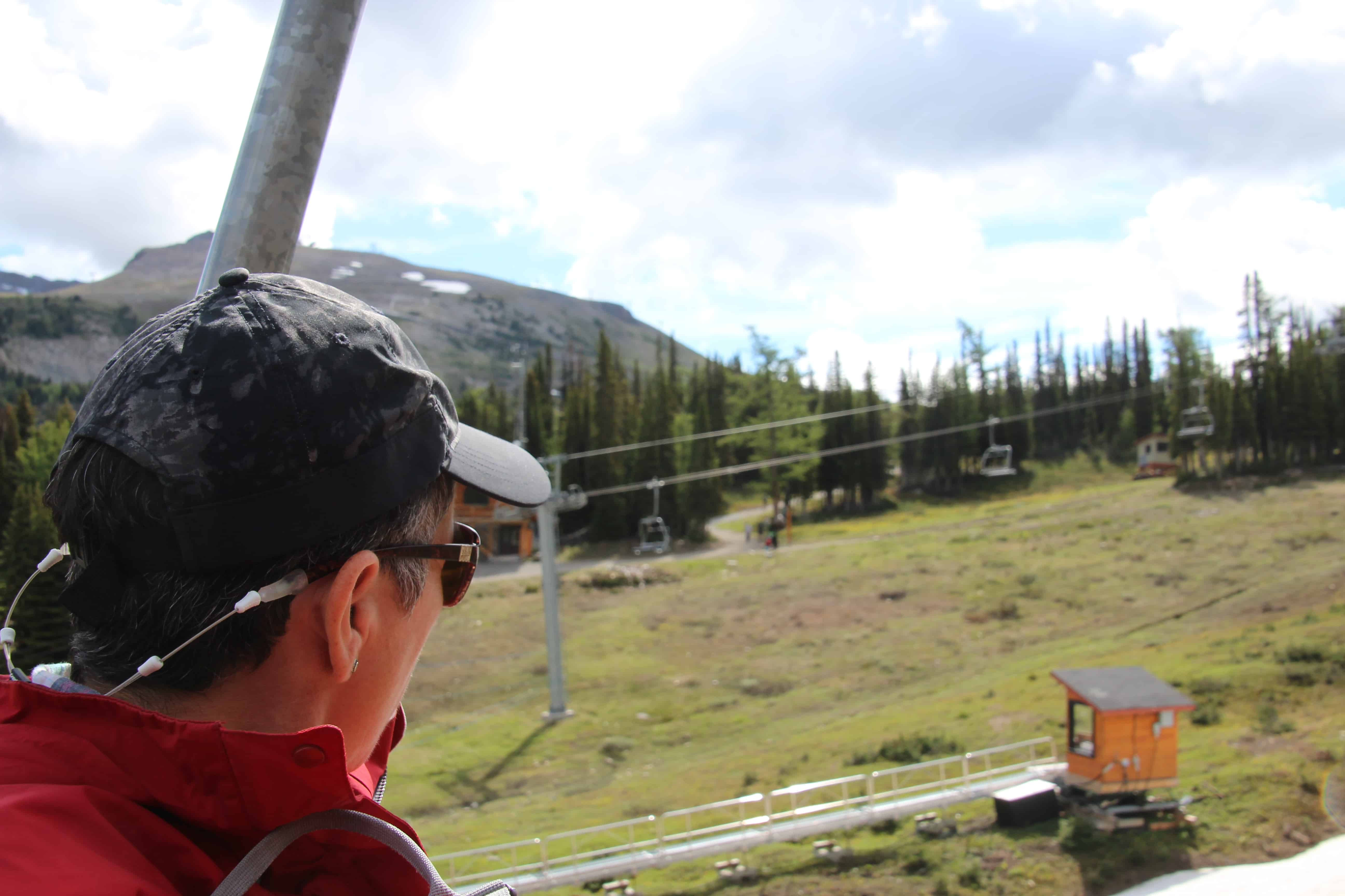 person on a chairlift, sunshine meadows banff