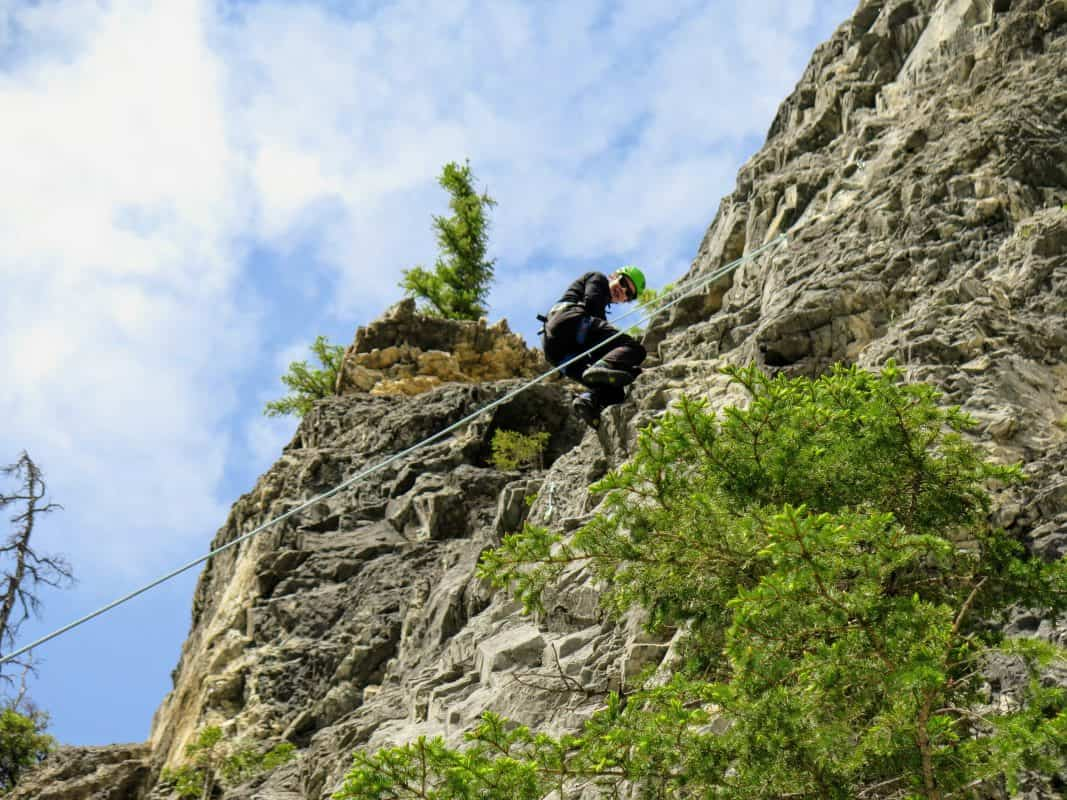climbing student descending