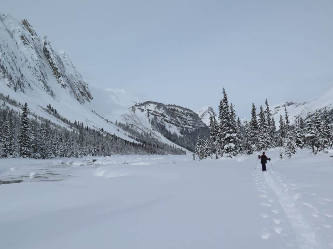 photo of a lady snowshoeing at Sherbrooke Lake, Yoho National Park