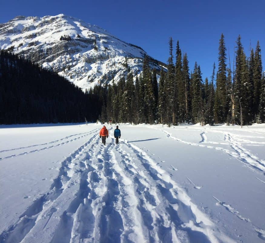Snowshoers crossing Hogarth Lake near the Rocky Mountains in Alberta