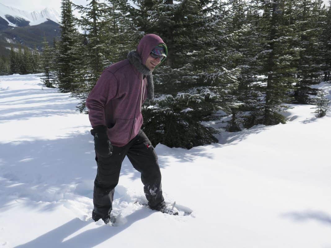 man snowshoeing in deep snow