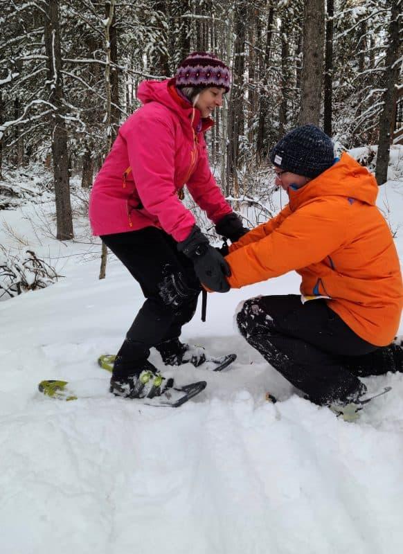 people demonstrating snowshoe technique