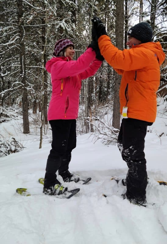 demonstrating snowshoe technique